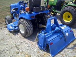 New Holland TZ25DA met middenmaaier en frees